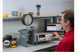 6270A Pressure Controller Calibrator calibrating a dial gauge